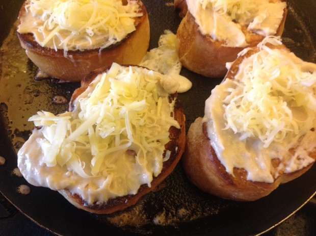 topped with bechamel sauce and grated cheese